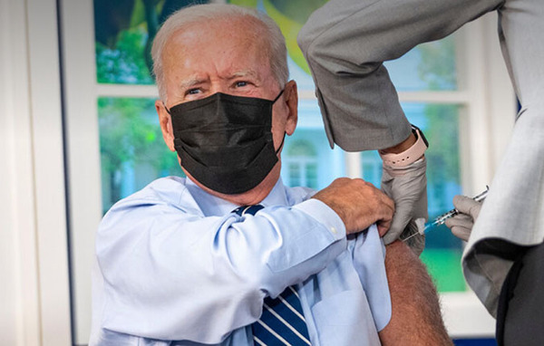 Biden gets Covid booster — on fake White House set